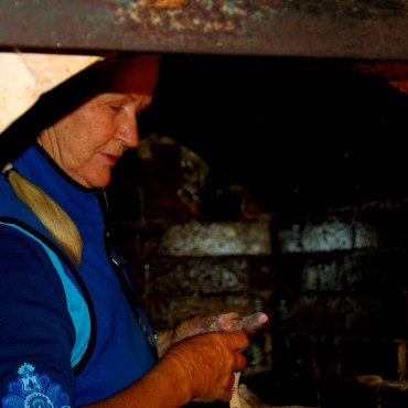 Ann Lee inside the Kiln-Loading