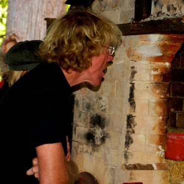 Warwick Anderson checking the loading of the woodfire kiln.
