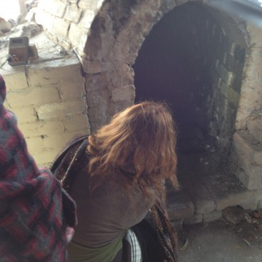 Truly Southurst examines the inside of Zak Chalmers- Valley Plains Pottery-kiln