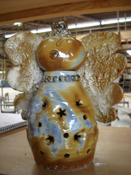 Clay Angel-Cone 10 Reduction-White Glaze With Other Layered Glazes and Iron.