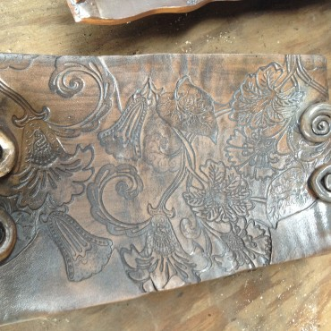 This platter is ok on construction but,....I used Iron and a clear glaze....HELP!