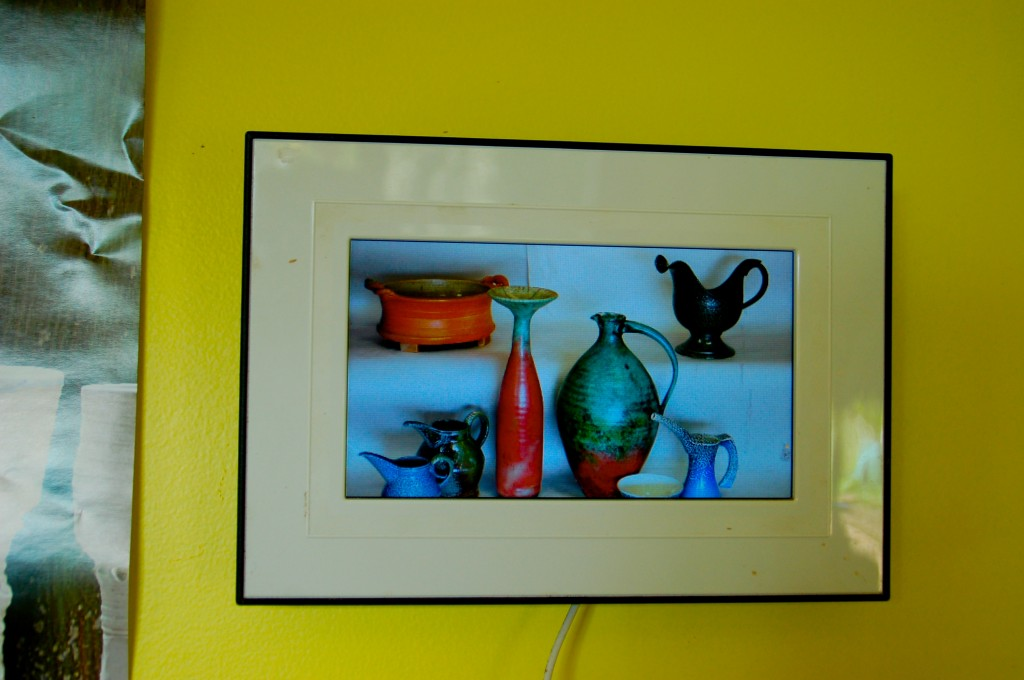 I use a memory card filled with pottery images I like on a photo frame.
