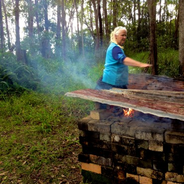 Ann Lee showing how much air the fire needs.