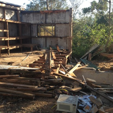 The side barn is coming down.