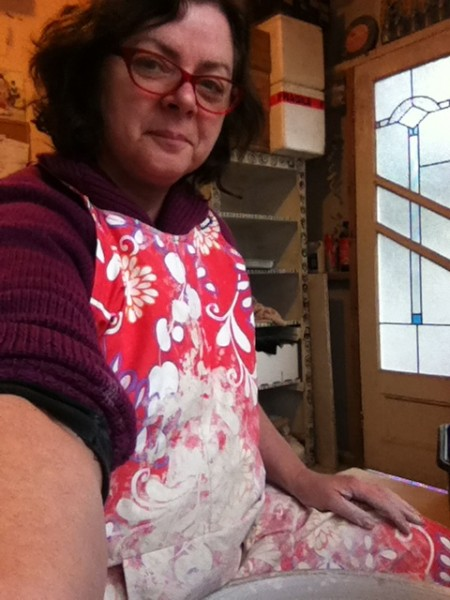 "Adriana Christianson in her ""Marian's Fabulous Pottery Apron"""