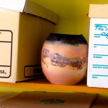 A saggar fired pot amongst storage boxes!