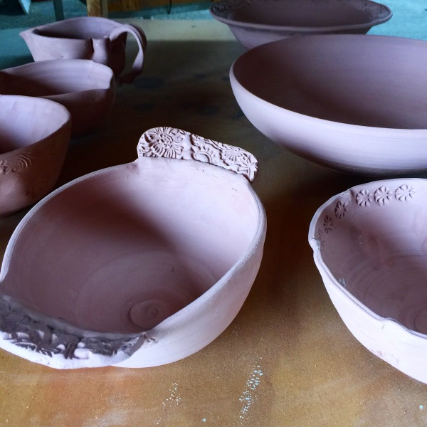 Pottery bowls, pottery stamps, altered pottery