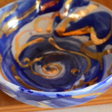 I did a whole series of porcelain with cobalt brush work and gold lustre.